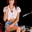 Pinup girl with custom chopper motorbike — Stock Photo #50650975