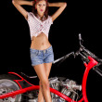 Pinup girl with custom chopper motorbike — Stock Photo #50655385