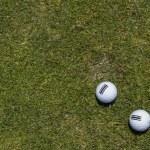 Three golf balls on a corner in a green grass — Stock Photo #50805161