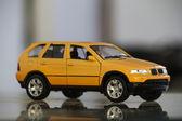 Yellow miniature toy car — Stock Photo