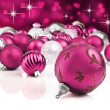 Pink decorative christmas ornaments with star background — Stock Photo #13389289