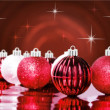 Red decorative christmas ornaments with star background — Stock Photo