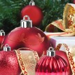 Christmas decorations under a christmas tree in red and gold — ストック写真