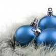 Colorful christmas baubles on a white background with space for text — Stock Photo #13389245