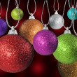 Colorful red green and other christmas baubles balls with colorful background — ストック写真