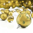 Golden decorative christmas ornaments with star background — Stock Photo