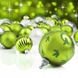 Green christmas ornaments with star background — Stock Photo