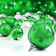 Stock Photo: Green christmas ornaments with star background