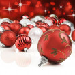 Red decorative christmas ornaments with star background - Stock Photo