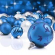 Blue decorative christmas ornaments with star background — Stock Photo