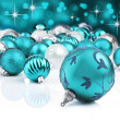 Blue decorative christmas ornaments with star background - Stock Photo