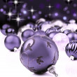Purple decorative christmas ornaments with star background - Stock Photo