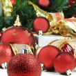 Christmas decorations under a christmas tree in red and gold — Stock Photo