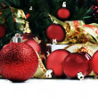Christmas decorations under a christmas tree in red and gold — Stockfoto