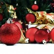 Christmas decorations under a christmas tree in red and gold - Stock Photo