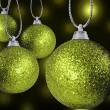 Close up of colorful christmas baulble ballsin different sizes hanging on strings — Stock Photo