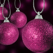 Close up of colorful christmas baulble ballsin different sizes hanging on strings — Стоковая фотография