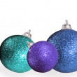 Christmas ball in different colors and sizes on a white background  — Stock Photo