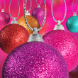 Close up of colorful christmas baulble ballsin different sizes  hanging on strings — ストック写真