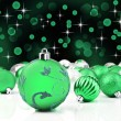Green christmas ornaments with star background — Foto Stock