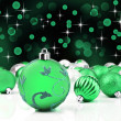 Green christmas ornaments with star background — Stok fotoğraf