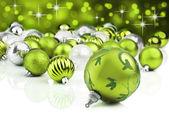 Groene kerst ornamenten met sterren achtergrond — Stockfoto