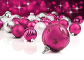 Pink decorative christmas ornaments with star background — Stock Photo