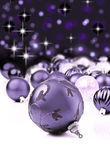 Purple decorative christmas ornaments with star background — Stock Photo