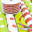 Christmas wrapping paper and ribbon — Stock Photo