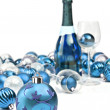 Blue Christmas ornaments with a bottle of sparkling wine — Stock Photo #13612624