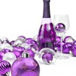 Purple christmas ornaments with sparkling wine — Stockfoto