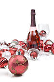 Red christmas ornaments with sparkling wine — Stock Photo