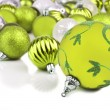 Green christmas ornament baubles on white — Stock Photo