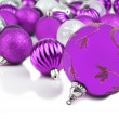 Purple christmas ornament baubles on white — Stock Photo