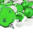 Green christmas ornament baubles on white — Stok fotoğraf