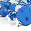 Blue christmas ornament baubles on white — Stock Photo