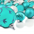 Blue christmas bauble ornaments on white — Stock Photo