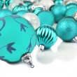 Blue christmas bauble ornaments on white — Stock Photo #13645834