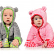 Stock Photo: Six month old twin brother and sister on white