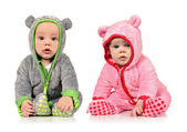 Six month old twin brother and sister on white — Stock Photo