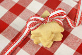 Star cookies with ribbon on checkered cloth — Stock Photo