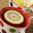 Healthy herbal tea with lemon in polka dot cups — Stock Photo