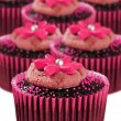 Delicious chocolate cupcakes in pink cups — Stok fotoğraf