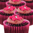 Delicious chocolate cupcakes in pink cups — Stockfoto