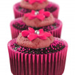Stock Photo: Lovely chocolate cupcakes decorated in pink