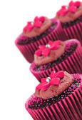 Lovely chocolate cupcakes decorated in pink — Stock Photo