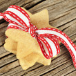 Star shaped cookies with red ribbon — Stock Photo