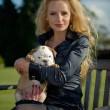 Beautiful blonde woman holding a puppy — Stock Photo #26820467