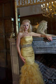 Beautiful blonde woman in luxurious interior — Стоковое фото