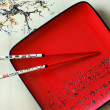 Japanese red dish and chopsticks — Stockfoto #12668087